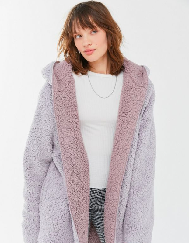 """This under-$100 teddy coat from Urban Outfitters is basically two coats in one because it's reversible. Plus, the lilac will stand out from a crowd of nudes. $79, Urban Outfitters. <a href=""""https://www.urbanoutfitters.com/shop/bdg-carmella-reversible-hooded-teddy-jacket?category=SEARCHRESULTS&color=040"""" rel=""""nofollow noopener"""" target=""""_blank"""" data-ylk=""""slk:Get it now!"""" class=""""link rapid-noclick-resp"""">Get it now!</a>"""