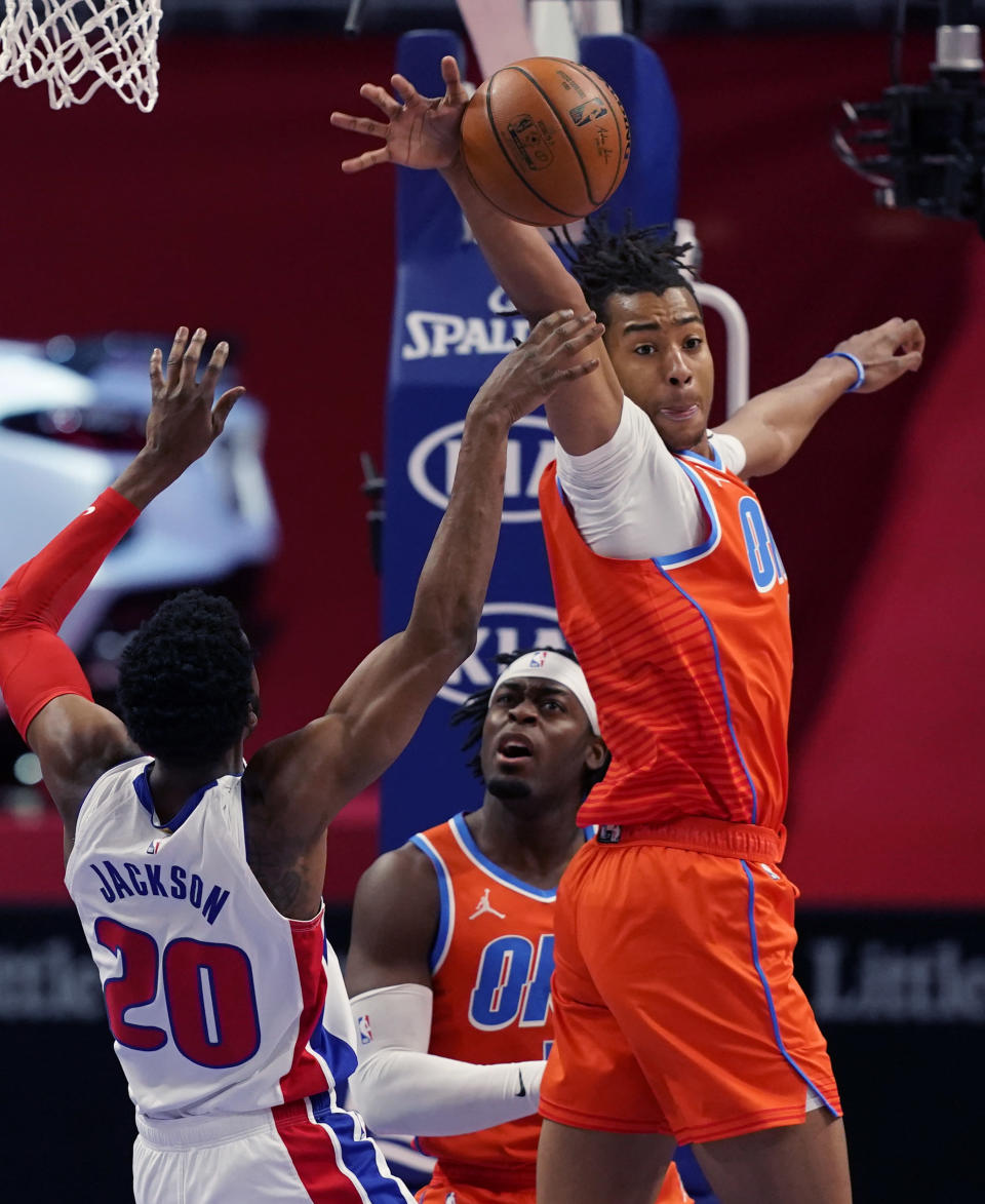 Oklahoma City Thunder center Moses Brown blocks a shot by Detroit Pistons guard Josh Jackson (20) during the first half of an NBA basketball game, Friday, April 16, 2021, in Detroit. (AP Photo/Carlos Osorio)