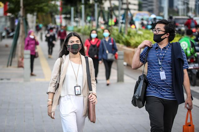 People wear masks in Jakarta, Indonesia. (Getty Images)
