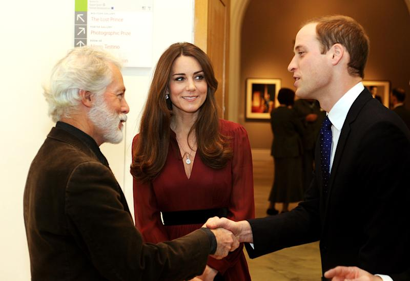 The Duke and Duchess of Cambridge meet artist Paul Emsley after viewing the newly-commissioned portrait of The Duchess of Cambridge at the National Portrait Gallery in central London, Friday Jan. 11, 2013. (AP Photo/PA, John Stillwell)