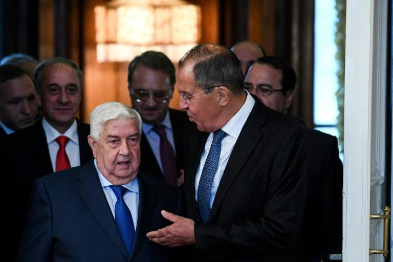 Russian Foreign Minister Sergei Lavrov gestures as he welcomes his Syrian counterpart Walid Muallem in Moscow on August 30, 2018