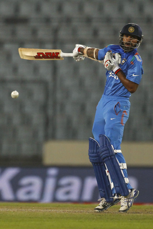 India's Shikhar Dhawan plays a shot during their match against Afghanistan in the Asia Cup one-day international cricket tournament in Dhaka, Bangladesh, Wednesday, March 5, 2014. (AP Photo/A.M. Ahad)