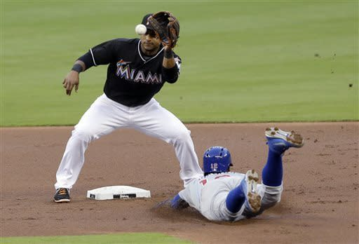 Miami Marlins second baseman Donovan Solano, left, puts out Chicago Cubs' Alfonso Soriano after Soriano attempted to steal second during the first inning of a baseball game on Friday, April 26, 2013, in Miami. (AP Photo/Wilfredo Lee)