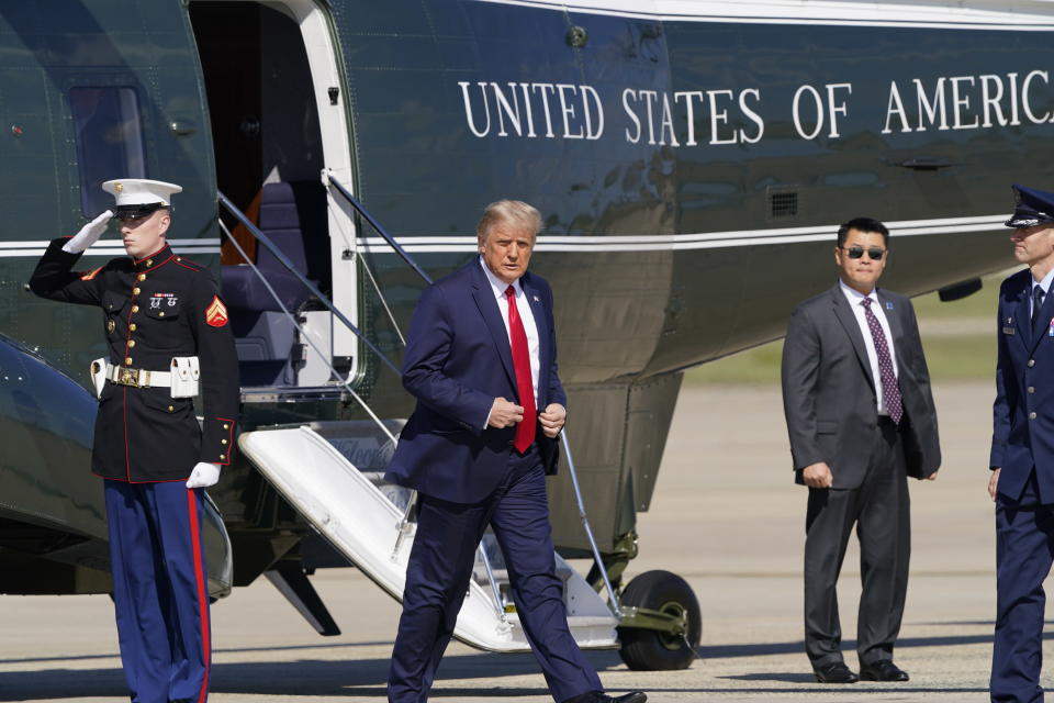President Donald Trump walks from Marine One towards Air Force One at Andrews Air Force Base, Md., Wednesday, Sept. 30, 2020. Fresh off the first presidential debate, Trump is returning to the battleground state of Minnesota for a rally and fundraiser. (AP Photo/Susan Walsh)