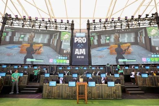 The Fortnite trophy is displayed as gamers compete in the Epic Games Fortnite E3 Tournament at the Banc of California Stadium