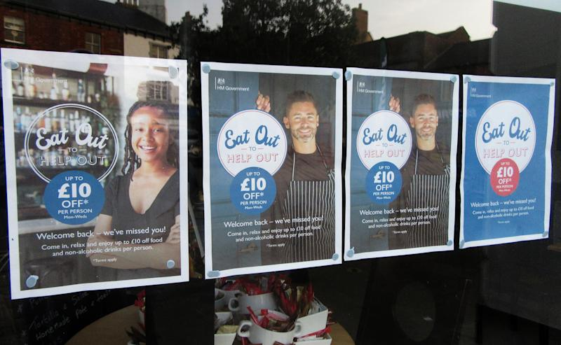 Advertisement signs seen outside a bar&restaurant for the Eat Out to Help Out scheme. UK Chancellor Rishi Sunak's �Eat Out To Help Out� scheme has been used over 10 million times in its first week. Diners receive a 50\% discount, up to �10 each, on food or non-alcoholic drinks every Monday, Tuesday and Wednesday during August. The scheme is to help boost the ailing hospitality industry which has been hard hit during the coronavirus pandemic. (Photo by Keith Mayhew / SOPA Images/Sipa USA)