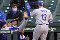 Los Angeles Dodgers manager Dave Roberts, left, congratulates Max Muncy after his solo home run during the fourth inning of a baseball game against the Chicago Cubs in Chicago, Wednesday, May 5, 2021. (AP Photo/Nam Y. Huh)
