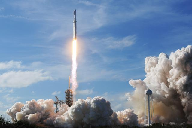 In its first full test flight, a SpaceX Falcon Heavy rocket launches from Pad 39A at the Kennedy Space Center in Florida, Feb. 6, 2018. (Photo: Jim Watson/AFP/Getty Images)