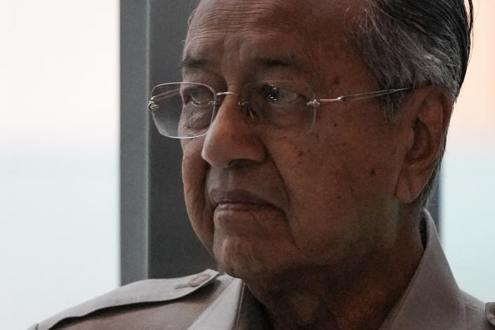 Malaysia's interim leader Mahathir Mohamad leaves after delivering a speech at the committee on the exercise of the inalienable rights of the Palestinian people, in Kuala Lumpur, Malaysia, Friday, Feb. 28, 2020. The speaker of Malaysia's House rejected Mahathir Mohamad's call for a vote next week to chose a new premier, deepening the country's political turmoil after the ruling alliance collapsed this week. (AP Photo/Vincent Thian)