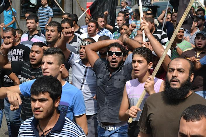 Lebanese protesters wave religious flags and shout slogans after Friday prayers as part of widespread anger across the Muslim world about a film ridiculing Islam's Prophet Muhammad in the northeastern city of Tripoli, Lebanon, Friday Sept. 14, 2012. (AP Photo)