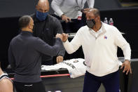 Los Angeles Clippers head coach Tyronn Lue, left, and Philadelphia 76ers head coach Doc Rivers greet each other after their NBA basketball game Saturday, March 27, 2021, in Los Angeles. The Clippers won 122-112. (AP Photo/Mark J. Terrill)