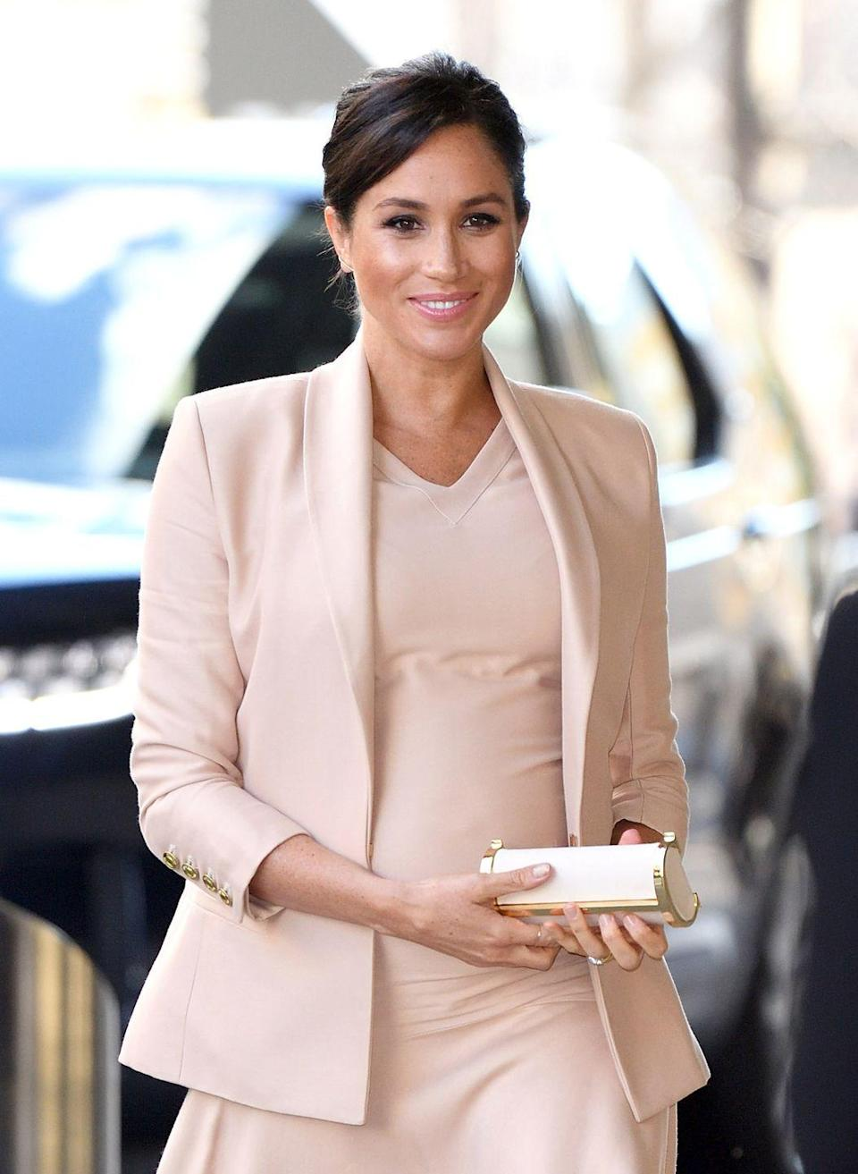 <p>While some of the royals prefer saturated pink, Meghan favors nearly-neutral blush-pink, like the sleek dress and jacket she wore to visit The National Theatre in London in January 2019. </p>