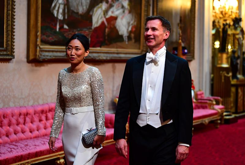 Mr Hunt and his wife Lucia at Buckingham Palace during the state visit of Donald Trump this month. (PA)