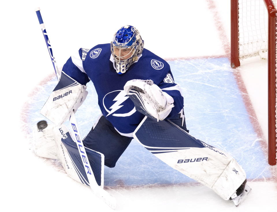 Tampa Bay Lightning goaltender Andrei Vasilevskiy (88) makes a save on the Columbus Blue Jackets during the third period in Game 1 of an NHL hockey Stanley Cup first-round playoff series, Tuesday, Aug. 11, 2020, in Toronto. (Frank Gunn/The Canadian Press via AP)