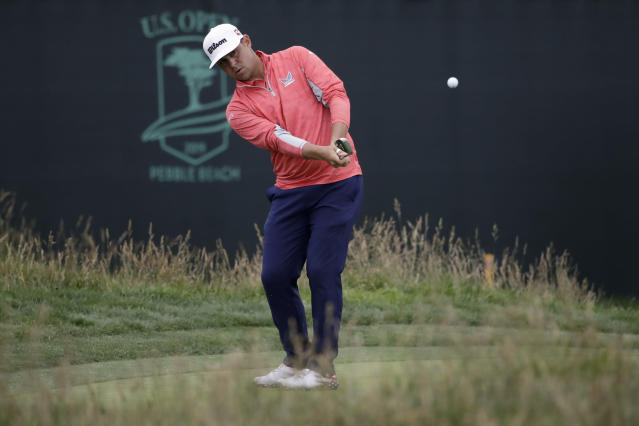 FILE - In this June 16, 2019, file photo, Gary Woodland chips off the 17th green during the final round of the U.S. Open Championship golf tournament, in Pebble Beach, Calif. Woodlands lob wedge was among the defining shots of the year. (AP Photo/Marcio Jose Sanchez, File)
