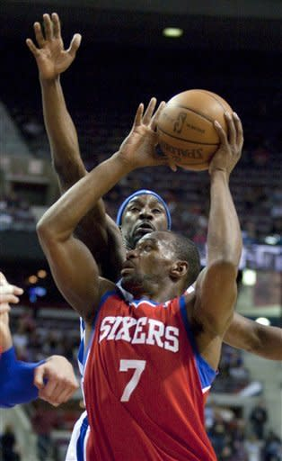 Philadelphia 76ers' Sam Young (7) goes to the basket past Detroit Pistons' Ben Gordon in the first half of an NBA basketball game on Thursday, April 26, 2012, in Auburn Hills, Mich. (AP Photo/Duane Burleson)