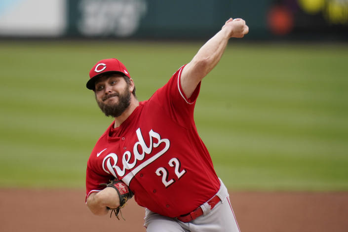 Cincinnati Reds starting pitcher Wade Miley throws during the second inning of a baseball game against the St. Louis Cardinals Saturday, April 24, 2021, in St. Louis. (AP Photo/Jeff Roberson)