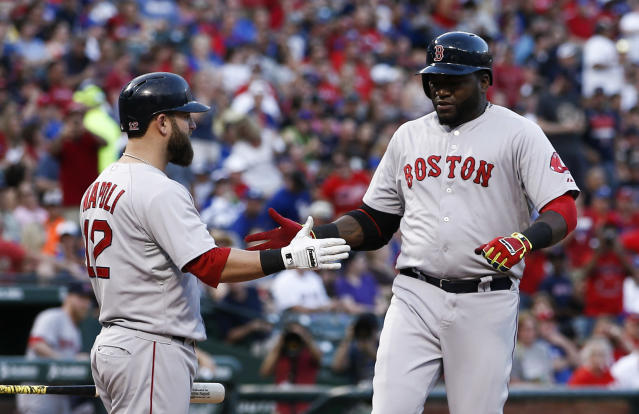 Boston Red Sox's David Ortiz, right, is congratulated by Mike Napoli after hitting a home run against the Texas Rangers during the third inning of a baseball game, Saturday, May 10, 2014, in Arlington, Texas. (AP Photo/Jim Cowsert)