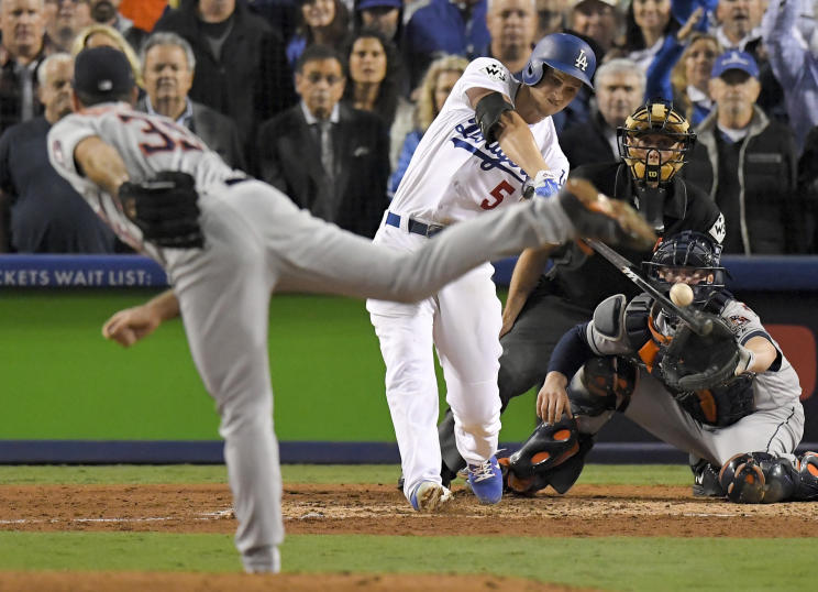Corey Seager hits a sacrifice fly off Houston Astros starting pitcher Justin Verlander to tie the game for the Dodgers. (AP)
