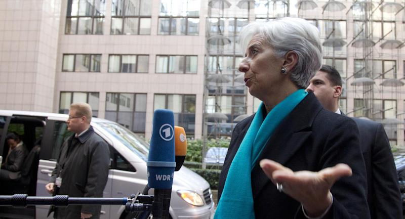 Managing Director of the International Monetary Fund Christine Lagarde, second right, speaks with the media as he arrives for a meeting of eurogroup finance ministers at the EU Council building in Brussels on Monday, Nov. 26, 2012. Eurozone finance ministers are set to meet in Brussels on Monday to discuss the next installment of bailout money for debt-laden Greece. (AP Photo/Virginia Mayo