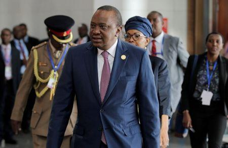 Kenya's President Uhuru Kenyatta arrives for the 30th Ordinary Session of the Assembly of the Heads of State and the Government of the African Union in Addis Ababa