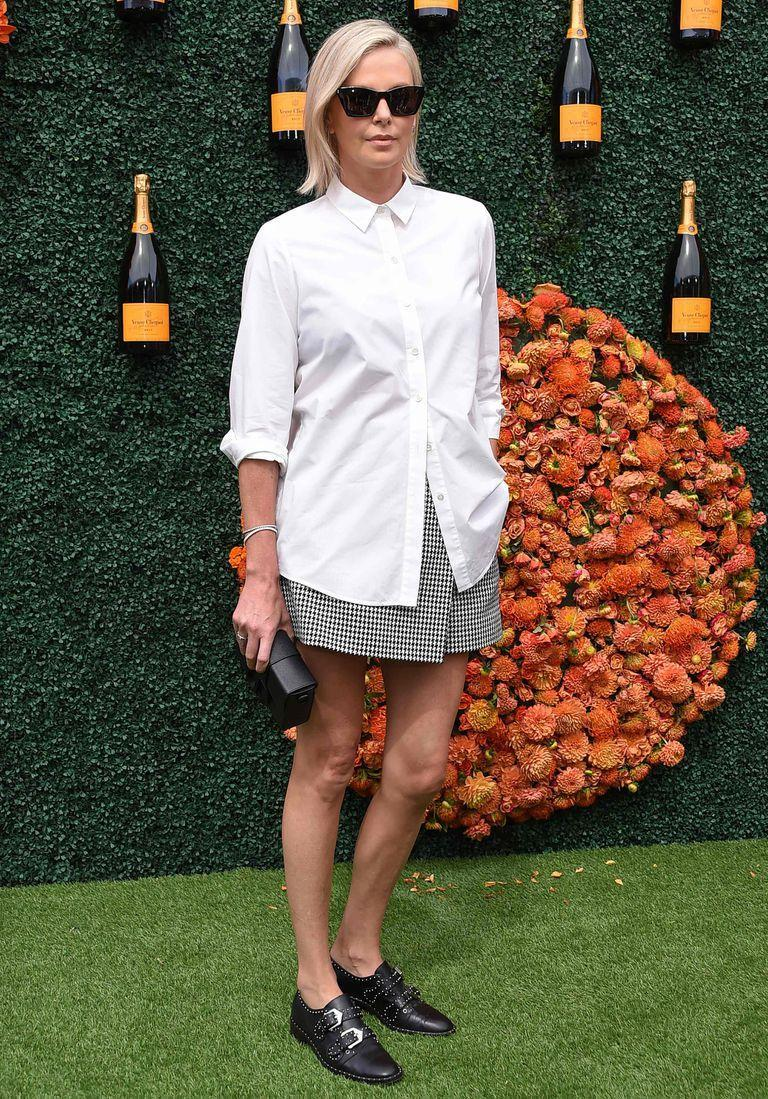 South African actress Charlize Theron arrives for the Veuve Clicquot Polo Classic 2021 at Will Rogers State Park in Pacific Palisades, California, on October 2, 2021. (Photo by LISA O'CONNOR / AFP)