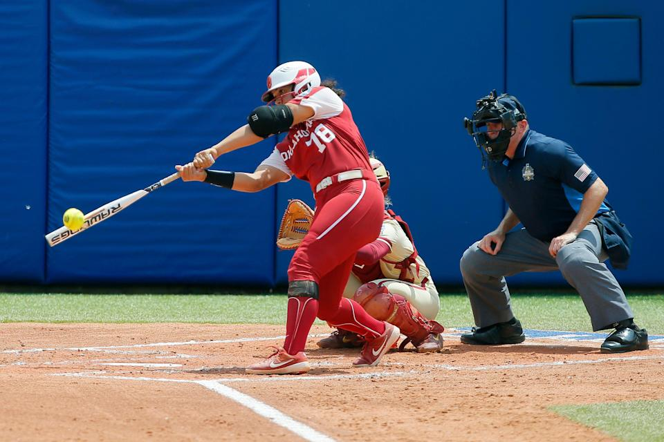 Oklahoma's Jocelyn Alo (78) hits a home run in the first inning during the final game of the Women's College World Series championship series between the University of Oklahoma Sooners (OU) and Florida State University at the USA Softball Hall of Fame Stadium in Oklahoma City, Thursday, June 10, 2021.