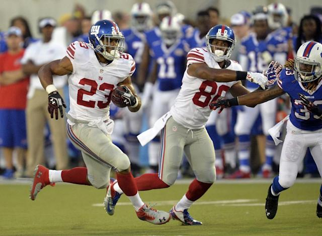 New York Giants running back Rashad Jennings (23) runs the ball in the first quarter against the Buffalo Bills at the Pro Football Hall of Fame exhibition NFL football game Sunday, Aug. 3, 2014, in Canton, Ohio. (AP Photo/David Richard)