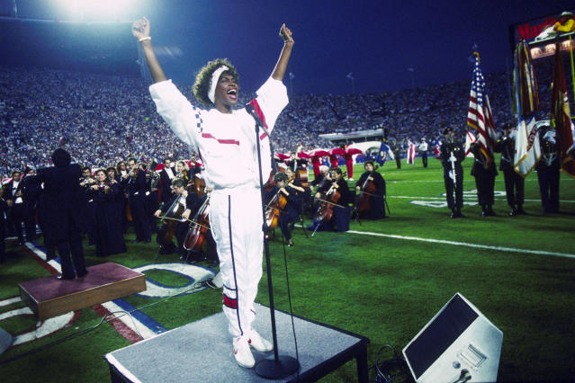 Whitney Houston takes the field for her triumphant rendition of 'The Star-Spangled Banner' at Super Bowl XXV. (Photo: Getty Images)