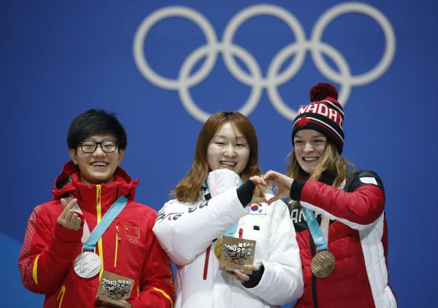Medals Ceremony - Short Track Speed Skating Events - Pyeongchang 2018 Winter Olympics - Women's 1500m - Medals Plaza - Pyeongchang, South Korea - February 18, 2018 - Gold medalist Choi Min-jeong of South Korea, silver medalist Li Jinyu of China and bronze medallist Kim Boutin of Canada on the podium. REUTERS/Kim Hong-Ji