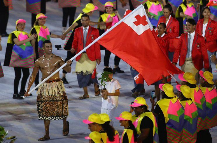 RIO DE JANEIRO, BRAZIL - AUGUST 05: Pita Nikolas Aufatofua of Tonga carries the flag during the Opening Ceremony of the Rio 2016 Olympic Games at Maracana Stadium on August 5, 2016 in Rio de Janeiro, Brazil. (Photo by Clive Brunskill/Getty Images)