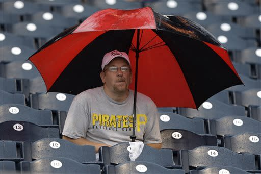 Mike Troupe, of Dubois, Pa., sits through a rain delay during a baseball game between the Pittsburgh Pirates and Chicago Cubs at PNC Park in Pittsburgh, Thursday, May 23, 2013. (AP Photo/Gene J. Puskar)