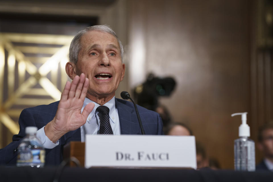 Top infectious disease expert Dr. Anthony Fauci pushes back on statements by Sen. Rand Paul, R-Ky., as he testifies before the Senate Health, Education, Labor, and Pensions Committee on Capitol Hill in Washington, Tuesday, July 20, 2021. Cases of COVID-19 have tripled over the past three weeks, and hospitalizations and deaths are rising among unvaccinated people. (AP Photo/J. Scott Applewhite, Pool)