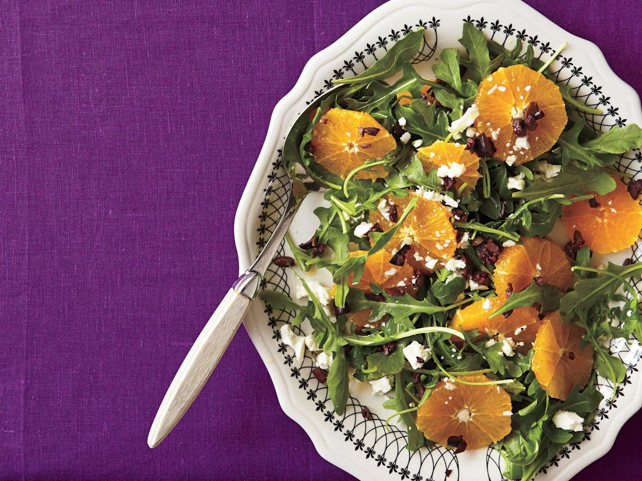 "<p>Skip the food coloring this year and bring Halloween hues to the table in the form of a healthy salad, instead. Orange slices, black Kalamata olives, feta, and a red wine vinaigrette infuse this arugula salad with bright Mediterranean flavors. </p><p><a href=""https://www.myrecipes.com/recipe/orange-black-salad-platter"">Orange-and-Black Salad Platter Recipe</a></p>"