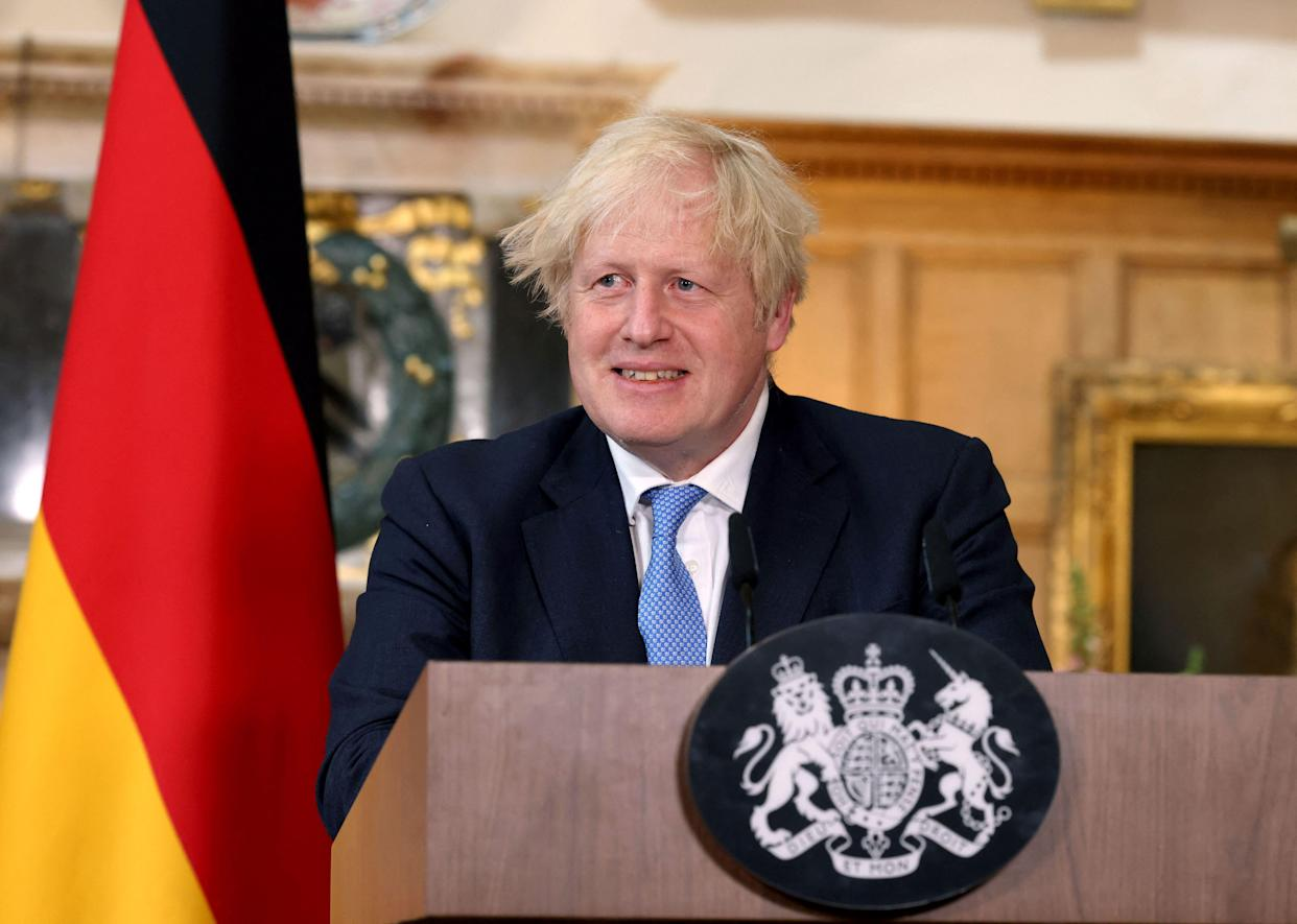 Britain's Prime Minister Boris Johnson speaks during a joint press conference with German Chancellor Angela Merkel following their bilateral meeting at Chequers, Buckinghamshire on July 2, 2021. - Prime Minister Boris Johnson hosts Merkel at his Chequers country residence during her 22nd and last official visit to Britain before she steps down as chancellor later this year. (Photo by Jonathan Buckmaster / various sources / AFP) (Photo by JONATHAN BUCKMASTER/AFP via Getty Images)
