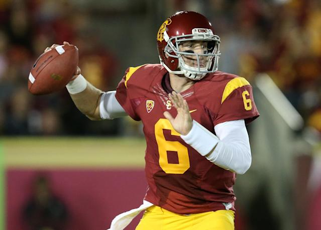 LOS ANGELES, CA - OCTOBER 10: Quarterback Cody Kessler #6 of the USC Trojans throws a pass against the Arizona Wildcats at Los Angeles Coliseum on October 10, 2013 in Los Angeles, California. (Photo by Stephen Dunn/Getty Images)