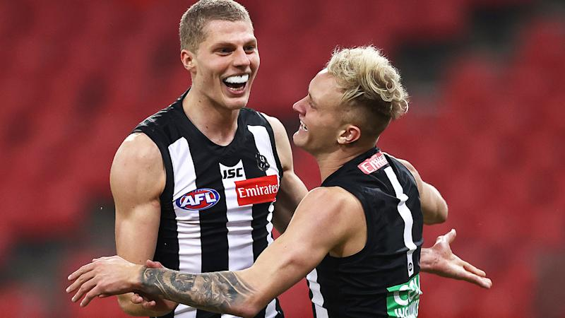 Will Kelly, pictured here celebrating his first AFL goal as Collingwood thrash Hawthorn.