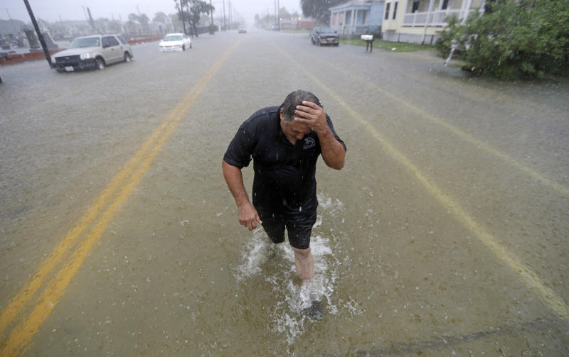 Angel Marshman wades through floodwaters from Tropical Depression Imelda after trying to start his flooded car, Sept. 18, 2019, in Galveston, Texas. (Photo: David J. Phillip/AP)
