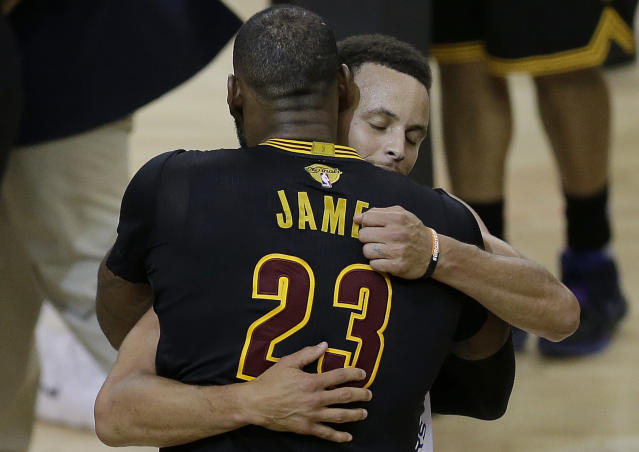 "<a class=""link rapid-noclick-resp"" href=""/nba/players/3704/"" data-ylk=""slk:LeBron James"">LeBron James</a> embraces the Warriors. (AP)"