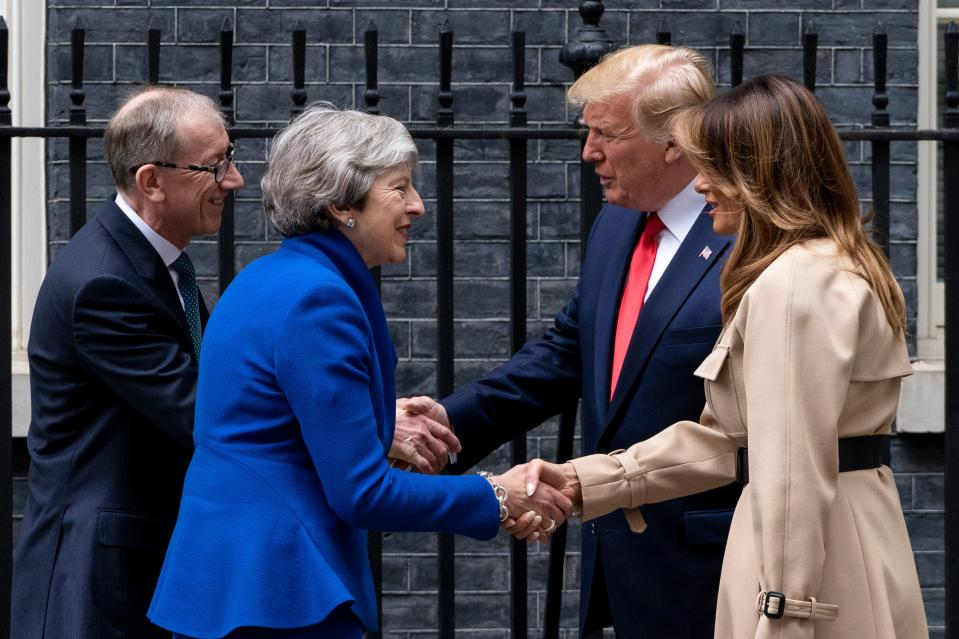 Britain's Prime Minister Theresa May and her husband Philip May greet US President Donald Trump and US First Lady Melania Trump outside 10 Downing Street. (Getty Images)