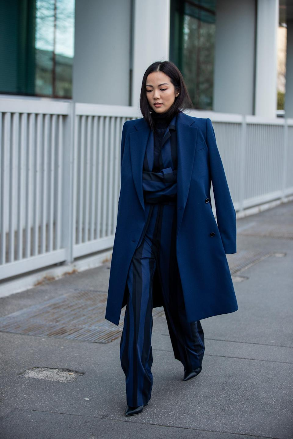 <p>Create a sleek look by matching your coat and suit.</p>