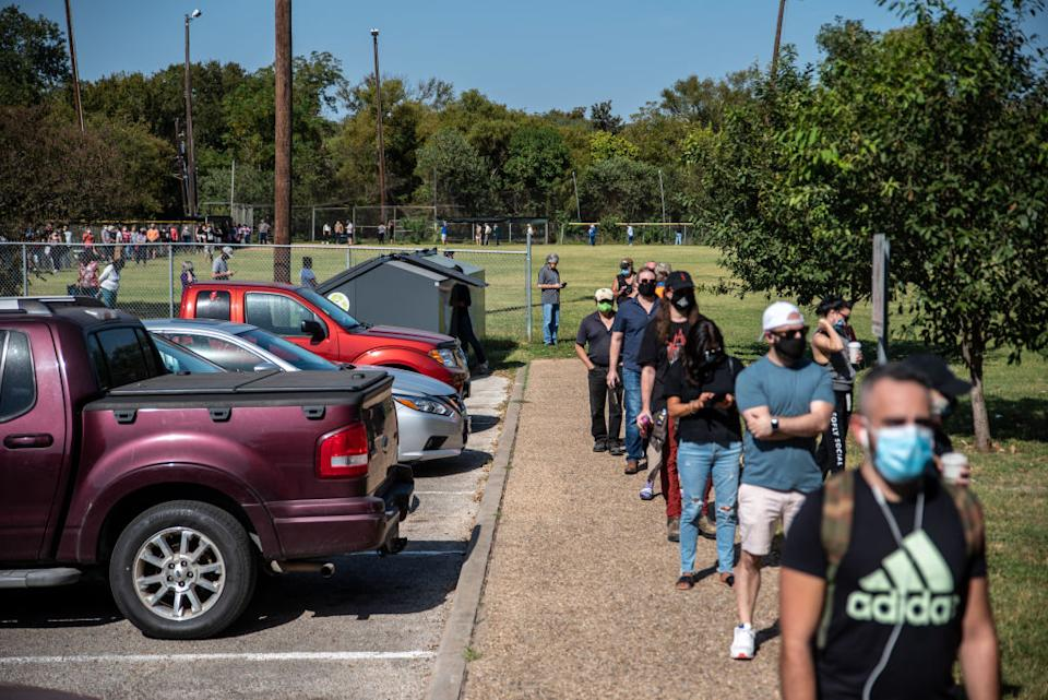Voters wait in line in Texas for the election.