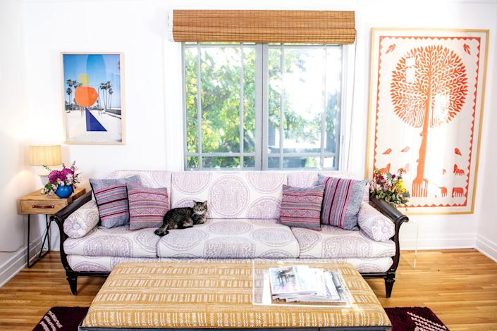 """The family room is where we find Elain, one of Myrin's four cats. <span class=""""copyright"""">(Mariah Tauger / Los Angeles Times)</span>"""
