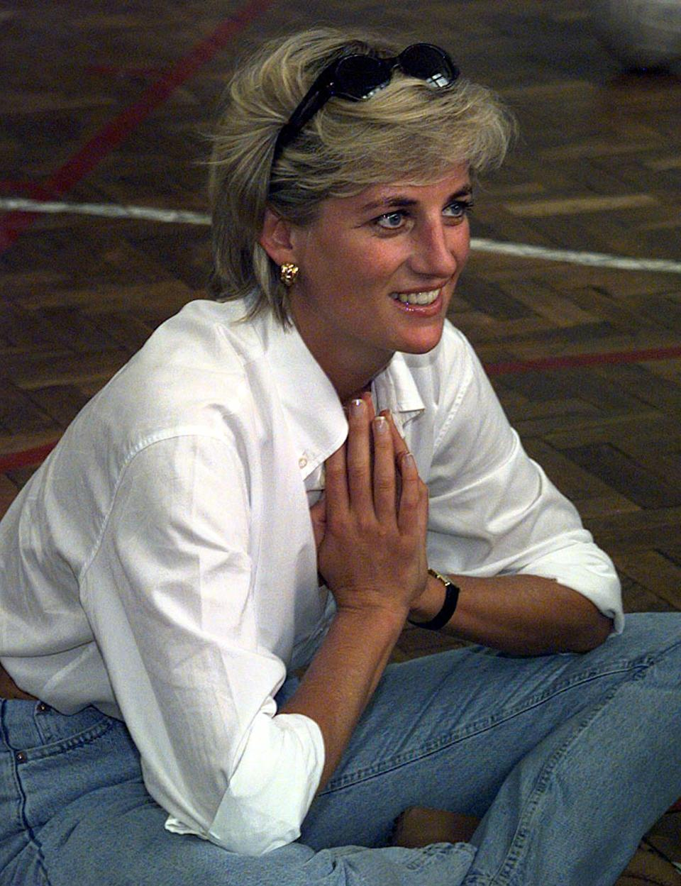 FILE PHOTO 9AUG97 - Diana, Princess of Wales sits cross-legged on the floor as she chats with members of a Zenica volleyball team who have suffered injuries from mines August 9, during Diana's visit to Bosnia and Herzegovina. Diana was seriously injured in a car crash in Paris early Sunday, French police said. Harrods heir Dodi Al Fayed was killed in the accident, which occurred shortly after midnight, police added.  FRANCE DIANA