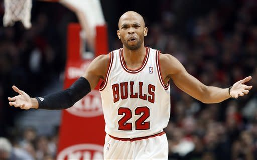 Chicago Bulls forward Taj Gibson reacts to a call during the first half of an NBA basketball game against the Phoenix Suns in Chicago on Saturday, Jan. 12, 2013. (AP Photo/Nam Y. Huh)