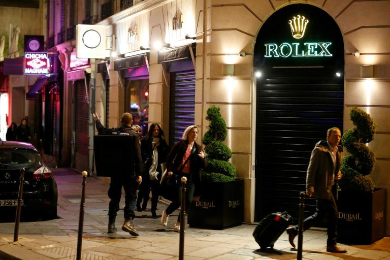 As a shooter opened fire on a police vehicle killing one officer and wounding two in Paris's famed Champs Elysees bystanders and tourists dashed for safety