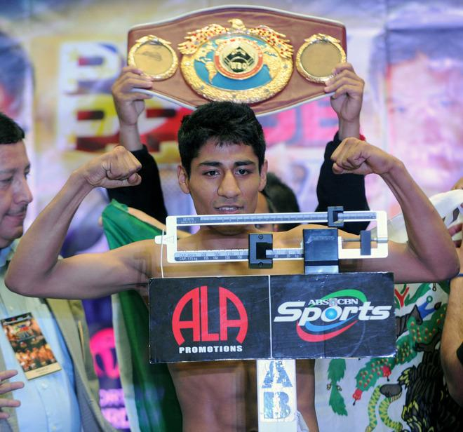 Mexican light-flyweight boxer Felipe Salguero flexes his muscles at the official weigh-in on June 1, 2012 in Manila.  Salguero will seek to wrest the World Boxing Organisation title from champion Donnie Nietes of the Philippines in Manila on June 2.     AFP PHOTO / Jay DIRECTOJAY DIRECTO/AFP/GettyImages
