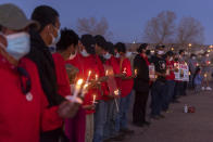 In this image provided by the Navajo Nation Office of the Speaker, family members and advocates participating in a candlelight vigil on the Navajo Nation, Wednesday, May 5, 2021, near Window Rock, Ariz., to commemorate a day of awareness for the crisis of violence against Indigenous women and children. (Byron C. Shorty, Navajo Nation Office of the Speaker via AP)