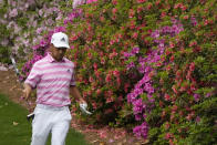 Xander Schauffele walks past azaleas on the sixth hole during the third round of the Masters golf tournament on Saturday, April 10, 2021, in Augusta, Ga. (AP Photo/Charlie Riedel)