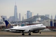 FILE PHOTO: A United Airlines passenger jet takes off with New York City as a backdrop